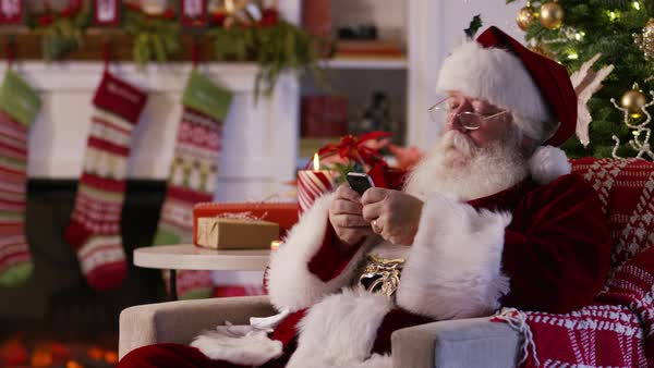 Santa Claus texting with cell phone Royalty-free stock video