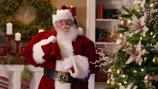 "Santa Claus waves and says ""Merry Christmas"" Royalty-free stock video"