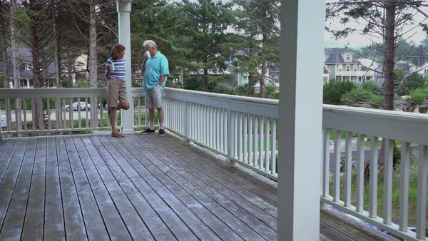 Senior couple having coffee on porch together Royalty-free stock video