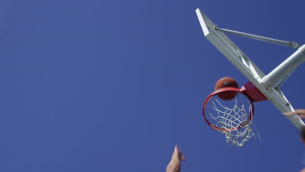 Low angle slow motion shot of man making basketball layup Royalty-free stock video