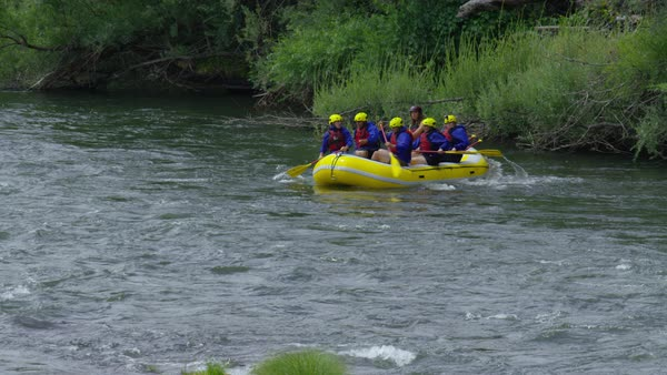 Group of people white water rafting celebrate Royalty-free stock video
