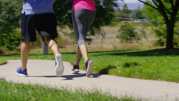 Couple running at park, closeup of feet Royalty-free stock video