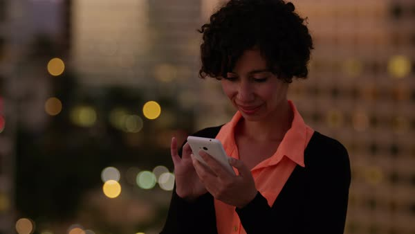 Woman using cell phone at night in city Royalty-free stock video