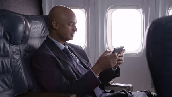 Businessman using digital tablet on airplane Royalty-free stock video