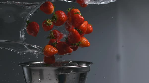 Strawberries flying out of colander in super slow motion Royalty-free stock video