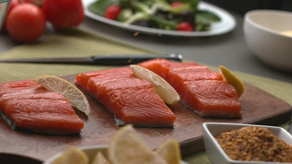 Seasoning falling onto Salmon fish in super slow motion Royalty-free stock video