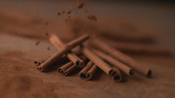 Cinnamon falling onto cinnamon sticks in super slow motion Royalty-free stock video