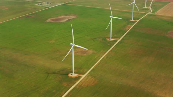 Aerial view of wind turbines in agricultural fields Royalty-free stock video
