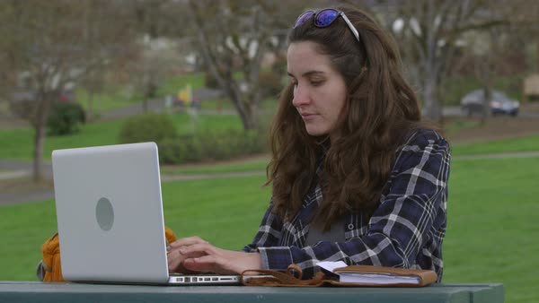 Woman at park on working on laptop computer Royalty-free stock video