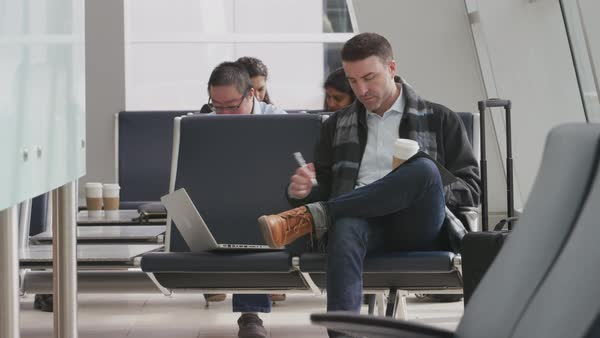 Businessman working at airport Royalty-free stock video