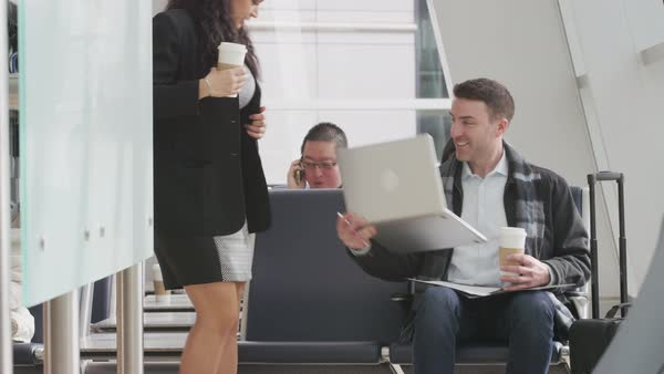 Businessman and businesswoman meeting at airport Royalty-free stock video