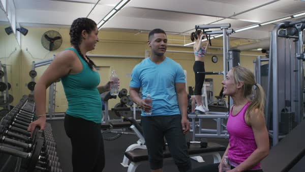Group of people talking together at gym Royalty-free stock video