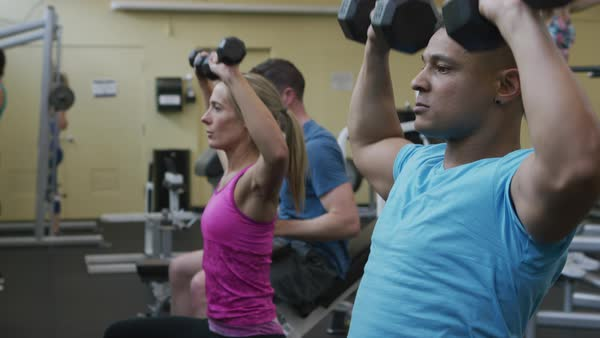 People lifting weights at gym Royalty-free stock video
