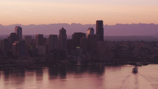 Aerial view of ferry and Seattle skyline at sunrise.   Royalty-free stock video