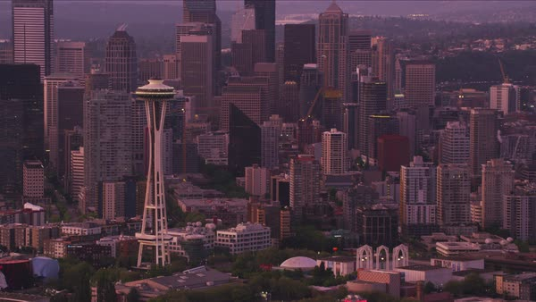Aerial view of Space Needle and city buildings at dawn.   Royalty-free stock video