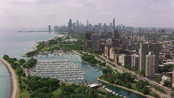 Flying over Belmont Harbor towards downtown Chicago.   Royalty-free stock video
