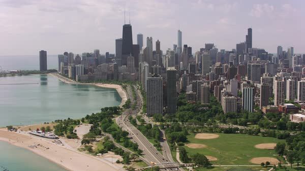 Flying over North Avenue Beach towards downtown Chicago.   Royalty-free stock video