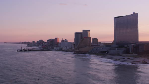 Aerial view of sun setting over Atlantic City.    Royalty-free stock video