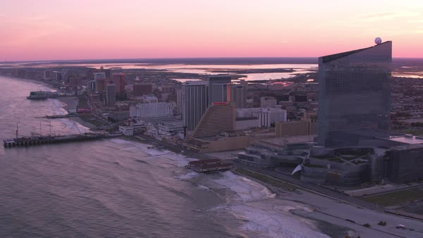 Aerial view of Atlantic City beach and piers at sunset.   Royalty-free stock video