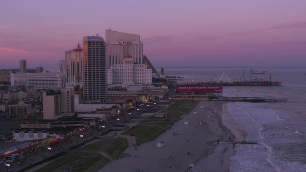 Flying up Atlantic City shoreline at sunset.   Royalty-free stock video