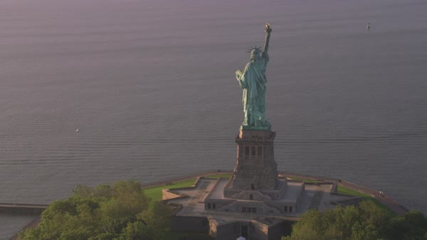 Aerial view of Statue of Liberty at sunrise, Manhattan.   Royalty-free stock video