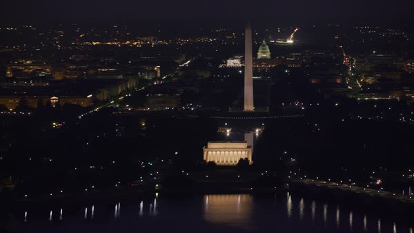 Early morning aerial view of the Lincoln Memorial, Washington Monument and Capitol Building at night.   Royalty-free stock video