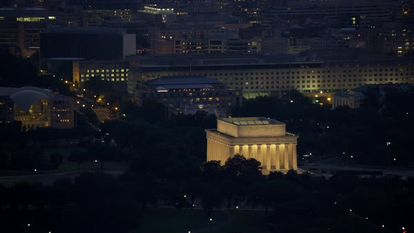Pull out form Lincoln Memorial to reveal city buildings and Potomac River.   Royalty-free stock video