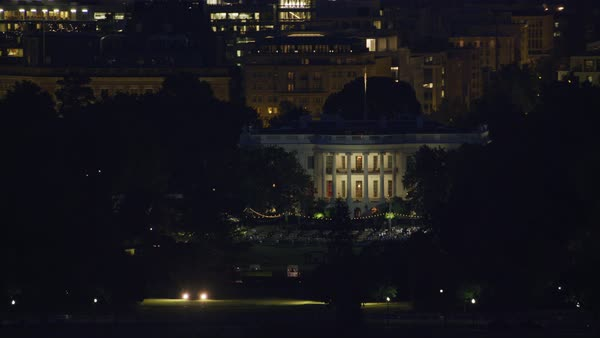 Aerial view as Washington Monument passes by White House at night.   Royalty-free stock video