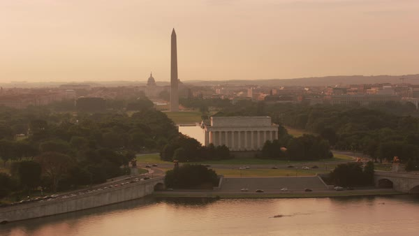 Aerial view of the Lincoln Memorial, Washington Monument and Capitol Building at sunrise.   Royalty-free stock video