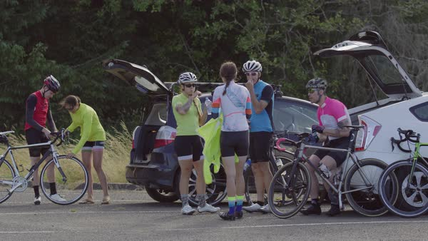 Group of cyclists taking break and preparing for ride Royalty-free stock video