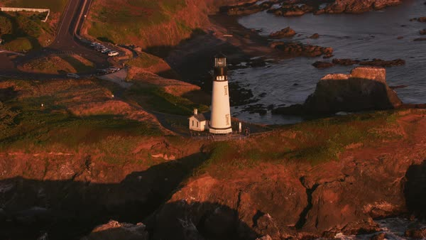 Aerial shot of Yaquina Head Lighthouse at sunset.   Royalty-free stock video