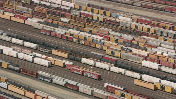 Aerial shot of train cars in train yard.   Royalty-free stock video