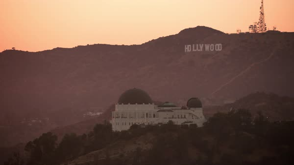 Aerial shot of Griffith Observatory and Hollywood sign at sunset.   Royalty-free stock video
