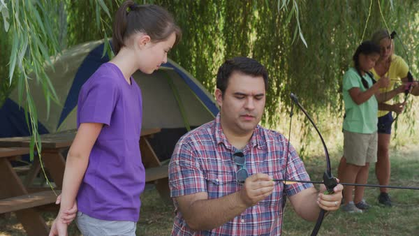 Kids at summer camp doing archery Royalty-free stock video