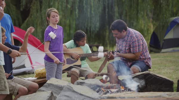Kids at summer camp around campfire Royalty-free stock video