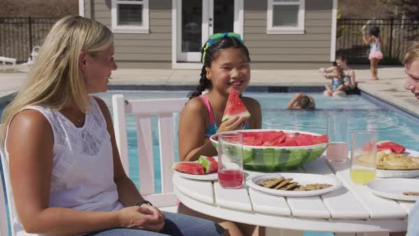 Family having lunch by backyard pool Royalty-free stock video