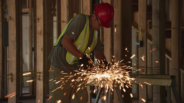 Construction worker grinding metal and making sparks, slow motion Royalty-free stock video