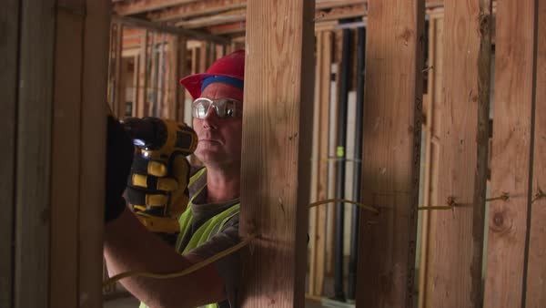 Construction worker using screw gun Royalty-free stock video
