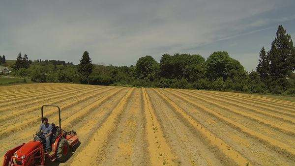Aerial shot of man driving tractor on farm Royalty-free stock video