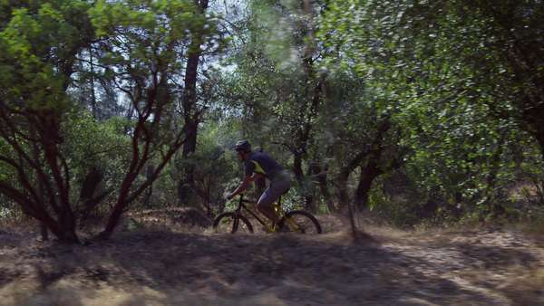 Tracking shot of man riding mountain bike in nature Royalty-free stock video