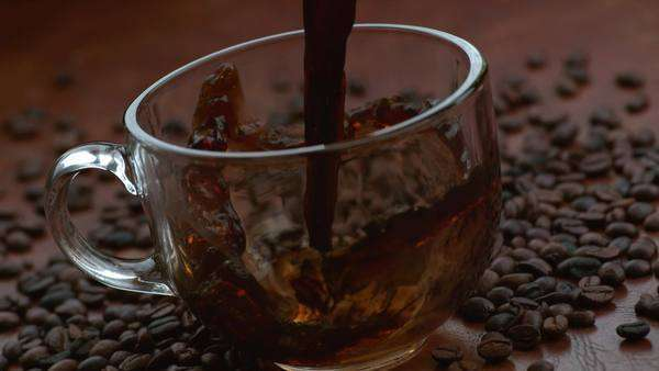 Coffee pouring into mug in slow motion Royalty-free stock video