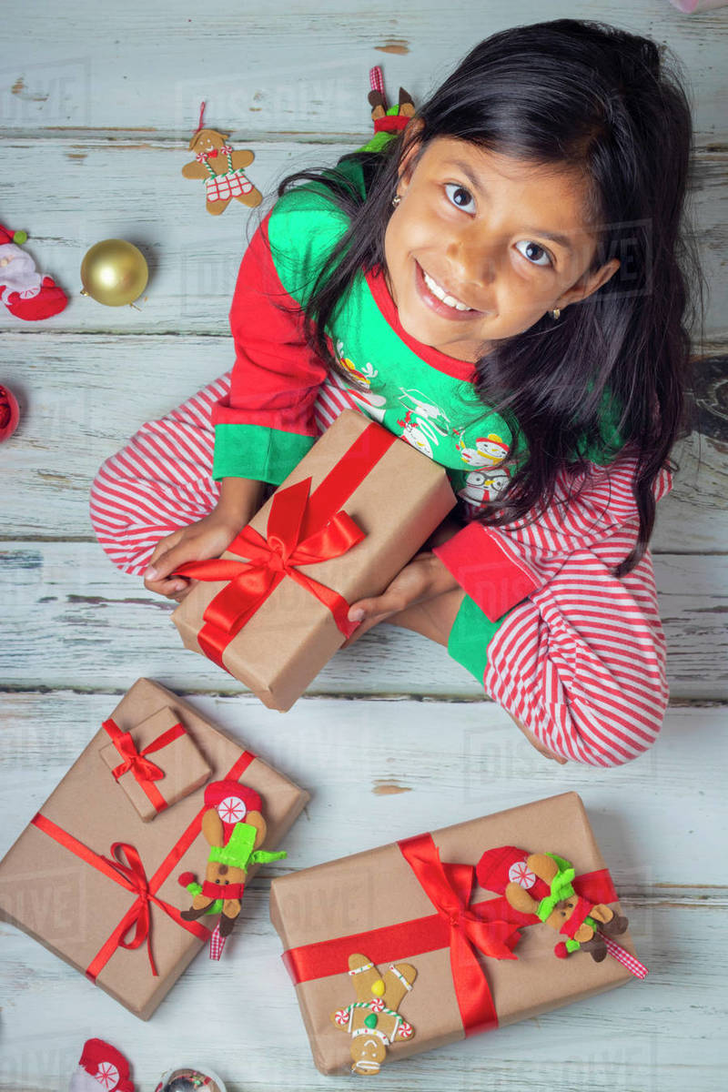 Little brunette girl with her presents on Christmas day Royalty-free stock photo