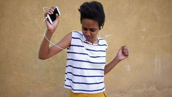 Portrait of a beautiful young woman dancing with earphones and cell phone Royalty-free stock video