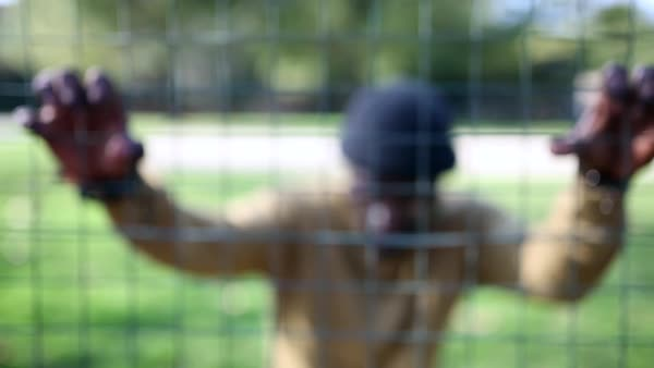Front view of a man looking at camera through a fence Royalty-free stock video