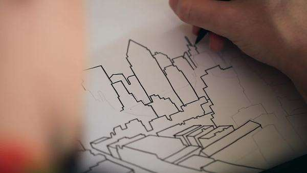 Close-up of a man drawing a sketch of an abstract skyline Royalty-free stock video