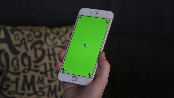 Locked off shot showing a handheld gadget with a green touchscreen Royalty-free stock video
