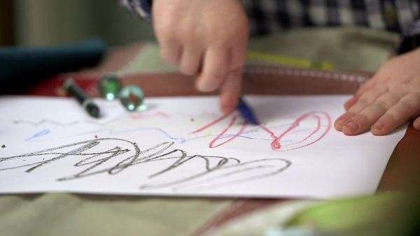 Close-up of young child drawing with crayons on table Royalty-free stock video