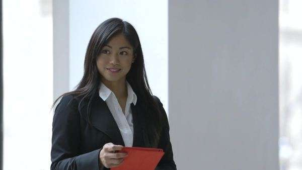Medium shot of businesswoman holding tablet Royalty-free stock video