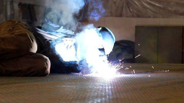 Medium shot of person welding metal plate Royalty-free stock video