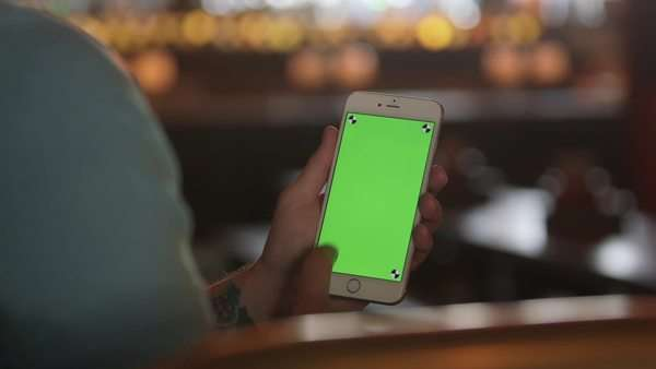Handheld shot of a man using a smartphone Royalty-free stock video